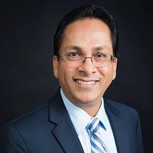 Manjit Gill - Director